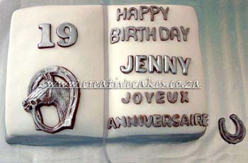 Sculptured Birthday Book Cake Decorated with Chocolate Writting and a Chocolate Horse for a 19th Birthday